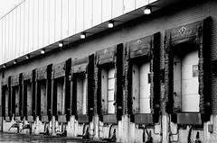 The Docks on a Rainy Day (andywilsonsphotos) Tags: bw andy wilson loadingdock loadingdocks andywilsonsphotos andywilsonsphotoscom