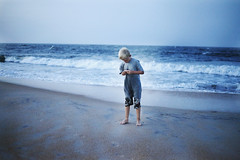 Low Tide (AshleyNMcfall) Tags: ocean blue boy summer beach water florida tide low combing