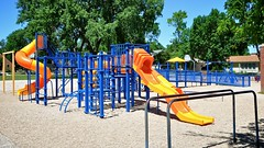 Stevens Elementary School playground (Dean Gulstad) Tags: summer usa color minnesota june midwest day unitedstates outdoor availablelight northamerica schools dawson mn 2009 smalltown digitalimage playgrounds nikond90 nikkor18105mm lacquiparlecounty