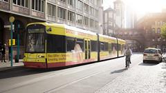 Sunny Evening (Igor Voller) Tags: germany evening sunny shining street tram cyclist taxi man yellow building brick red               deutschland strase strasenbahn fahrrad mensch gelb rot sonnelicht         frankfurt summer sommer    reflection