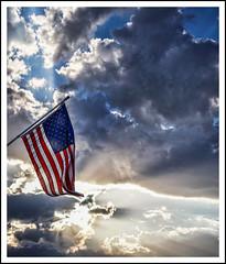 Flag at sunset (FotosDeLisa) Tags: a6300sigma6028 flag clouds sunrays