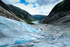 The beauty of a glacier (Tommy Høyland) Tags: noruega cascades natural jostedalsbreen nature dangerous scandinavia beauty lake white snow water view global national valley travel field north scenic hiking sky environment tongue melt texture ice deep summer spectacular danger landscape sognefjorden sogn rock people river park outdoor glacier nigardsbreen norvegen crack norway high blue colorful briksdal mountain norwegian luster glacial cold tour age frozen tourism iceberg detail