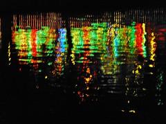 rainbow theatre - Reflexion im Main, Michaelismesse in Miltenberg 2016 (zikade) Tags: reflexionen licht farbigeslicht farben gelb orange feuer main miltenberg odenwald kirmes blau trkis grn wasser spiegelung volksfest michaelismesse 2016