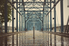 Rain On The Bridge (Brad Lackey) Tags: walnutstreetbridge chattanooga tennessee pedestrian bridge historic wood steel tennesseeriver blue reflection rain summer bokeh nikon50mmf18 d7200