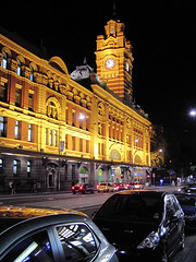 Flinders St. Station (russelljsmith) Tags: city travel autumn vacation holiday building tower fall cars clock station night lights australia melbourne victoria front fiends flindersst 2011 77285mm
