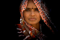 in the heat of the night (Handheld-Films) Tags: travel red portrait people woman india black closeup intense faces indian documentary portraiture expressive rajasthan headandshoulders womenofindia gujar ruralrajasthan indianportraits