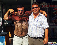 Hairy man and friend (Don Jackson) Tags: life street portrait people urban hairy abstract man sexy male strange face smiling laughing hair naked happy weird friend funny couple exposure arms body pavement expression fat profile joy photojournalism documentary surreal sunny social stare suntan unusual gesture unshaven obese global srtipes