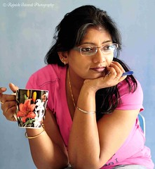 In deep thoughts .... (rajnishjaiswal) Tags: pink blue cup coffee girl lady pen 50mm nikon gimp