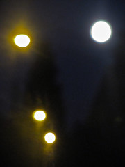 We Reach for the Moon (Dead  Air) Tags: trees summer sky moon night portland darkness streetlamps streetlights stjohns august fullmoon nighttime wires glowing aquarius telephonewires olympiastreet