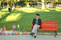 Lonely man who's waiting for...? (Sobanland) Tags: park street old red food parco colour verde green beautiful loving relax toys happy europa europe alone loneliness oldstyle traditional peaceful happiness sunny oldman east erba balkans tradition typical albanian albania prato easterneurope est lodra balkan orientale giocattoli albanese tirana kidstoys balcani lonelyman shqiptar tirane shqiperi shqiperia shqip kuqe shqipëria tiranë vjetër