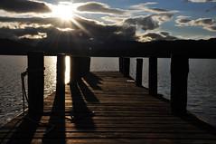 Low Wood Pier landscape. (luke_million) Tags: uk blue sunset sky lake mountains water clouds landscape pier shadows bright district lakes shining