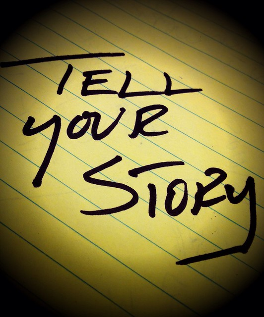 tell your story scribbled in pad
