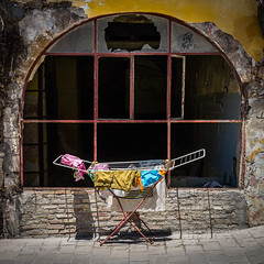 Hanging out... (Cirrusgazer) Tags: streetphotography washing drying hangingout colour textures weathered bill clotheshorse sunlight shadows summer chania crete greece clothes