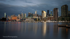Melbourne skyline at dusk from Victoria Harbour (trevorjphotography) Tags: marina victoriaharbour melbourne australia cbd docklands eithadstadium rialtotowers longexposure ndfilter neutraldensityfilter fotga bulbmode manual le smoothwater reflection liquid blurrywater icywaters canoneos5dmarkii ef1740mmf4lusm cloudy fadinglight intervalometer remotetimer tripod seascape waterscape cityscape wideangle lserieslens contrast winter skyscrapers buildings tallbuildings lowlight