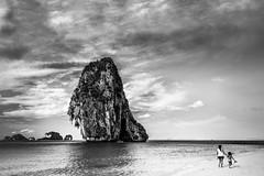 ... (torbus) Tags: beautiful thailand limestonecliff blackwhite landscape asia nopparatharabeach phranangcavebeach people aonang monotone darkness raileybeach travelphotography cliff krabi