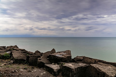 15 seconds on the Lake (lnoelle89) Tags: ontario lakeontario lakeside greatlake greatlakes canada clouds colours colors smooth rocks rocky purple blue aqua canon canon6d nature canonphotography canonofficial canond notl niagaraonthelake photography longexposure exposure weather horizon overcast