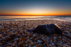 Pebbles and Marbles (pidalaphoto) Tags: water lighthouse newyork orientpoint sunrise longisland orientny longislandsound