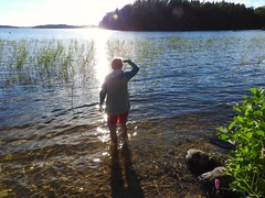 One of the amazingly clear lakes of the lake area of Finland (KaarinaT) Tags: lake finlandslakearea finlandslakecountry sparklywater woman summer water clearwater sunrays