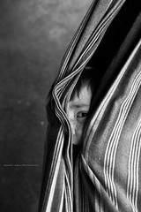 Child wrapped up in a hammock (Robert Lang Photography) Tags: blackandwhite canvas childish colour hammock hide hiding imagination play relaxing wrappedup