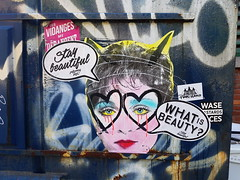 Stay Beautiful - What is beauty? (Exile on Ontario St) Tags: staybeautiful poster montreal stay beautiful print streetart street art griffintown trottoir sidewalk woman femme lunettes posterart glasses spectacles graffiti eyes circles circle damaged ripped torn yellow jaune madonna singer artist entertainer eighties 80s 1980s annes80 dumpster container conteneur dchets vidanges poubelles drangent montral beauty whatisbeauty