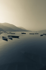 Boats on the lake (sequoiaseed) Tags: sunrise lake pokhara nepal boats water landscapes underwater mountains sky