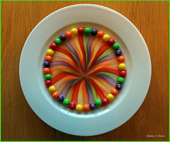 Taste The Rainbow (mattpacker1978) Tags: color colours rainsbow candy sweets pretty illusion plate table water dye run skittles lovely picture awesome green red purple yellow orange arty art capture photo canon 700d dslr digital 1855mm home trial fun