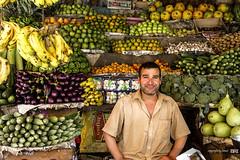 salesman_at_the_market (alamond) Tags: portrait india fruit canon us market vegetable 7d ef 1740mm manali 1740 salesman brane f4l llens alamond zalar