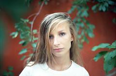 Lulu (4) (Radu Lungu) Tags: red portrait plants film girl 50mm dof kodak bokeh olympus negative romania blonde epson om f18 ti zuiko constanta ektar om4 v500 om4ti