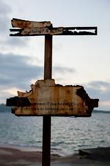 Worrisome Sign In Bugibba (cliff.hellis) Tags: ocean sea water sign warning rusty malta creativecommons bugibba yabbadabbadoo