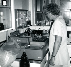 Adjusting a testing machine (PUC Special Collections) Tags: laboratory lab pacificunioncollege chemistrydepartment chemistrylab chemistry beakers test tubes scientist labcoat experiments angwin california adventist sda seventhdayadventist college