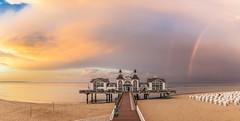 Sunset and Rainbow (E.J.A. Photo) Tags: rainbow afterrain sunset seebrcke sellin ostsee balticsea sonnenuntergang meer sea beach