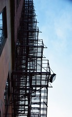 Escape (marensr) Tags: fireescape stairs metal sky sunset linear architecture blue hyde park chicago