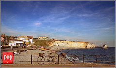 Freshwater Bay (Jason 87030) Tags: freshwaterbay island iow isleofwight coast sea sunny summer hoilday 2016 sunbathers beach bike bicycle cliffs sand tide clouds sky composition bathers bikini people color colour rnli boats tourists vacation seaside