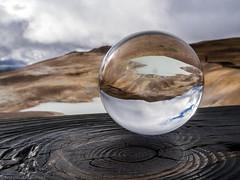 Alone in the globe (katrin glaesmann) Tags: unterwegsmiticelandtours photographyholidaywithicelandtours mvatn krafla leirhnjkur crystalball iceland wood railing clouds wet
