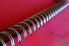 Repetition (Zsofia Nagy) Tags: flickrlounge weeklytheme repetition spiral red stationery metal d3100 depthoffield dof diagonal abstract indoor