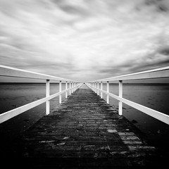 Pier 5 (Mabry Campbell) Tags: longexposure blackandwhite bw lines photography pier photo skne spring europe sweden horizon perspective may symmetry photograph le 100 sverige scandinavia malm squarecrop malmo springtime 2012 leadinglines f20 17mm skane southernsweden ef1740mmf4lusm pier5 southsweden 300sec may192012 mabrycampbell tipofsweden 201205190005
