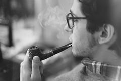Marzo (Halloground) Tags: boy portrait bw guy film 50mm glasses pipe bn smoking smoker canonae1 ritratto marzo pipa occhiali pellicola pipesmoker analogico maggese