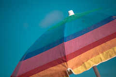 Two Shades Down (Mabry Campbell) Tags: morning usa gulfofmexico umbrella photography us photo colorful texas gulf tx unitedstatesofamerica fineart july sunny bluesky photograph summertime 100 freeport umbrellas f28 2012 surfside 200mm surfsidebeach ef200mmf28liiusm brazoriacounty sec makingshade mabrycampbell july72012 201207072352