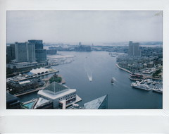 Baltimore's Inner Harbor from the 'Top of the World' (ashleycampbell) Tags: city sky film water clouds buildings polaroid boats harbor boat md fuji view maryland baltimore instant innerharbor fuji210wideformatinstantcam