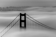 Fogged In - Golden Gate Bridge (tobyharriman) Tags: pictures sf sanfrancisco blackandwhite bw colors fog clouds sunrise canon landscape photography blackwhite photographer foggy scenic may trails goldengatebridge 7d bayarea scape marinheadlands 2012 tobyharriman slackersridge