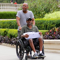 Wheelchair Buddies (LarryJay99 ) Tags: park urban hairy chicago man male men guy ma masculine wheelchair manly bald parks guys sneakers dude cap males facialhair dudes stud blackmale studs urbanscape sunnyday virile canonefs18135mmf3556is ilobsterit