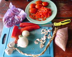About $1.50 worth food (South for Sunshine) Tags: chile food tomato pepper rice guatemala comida knife meal garlic onion xela cuttingboard