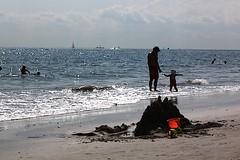 IMG_2947 (yiching.lin) Tags: ocean nyc newyorkcity beach wet coneyisland sand waves dress fancy improv gown tux blacktie dressed dressy tuxedos stunt flashmob improveverywhere coneyislandbeach eveningwear blacktiebeach2012