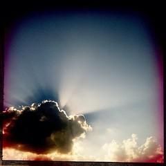 Apollo's chariot (Da vi De ) Tags: blue light sky cloud sun sunlight color station silhouette clouds composition contrast reflections square mediterranean colours force bright lofi bluesky elements squareformat flare rays sunrays davide mediterranea lomofi iphoneography hipstamatic instagramapp uploaded:by=instagram foursquare:venue=4c35cd0da0ced13ae74e1a6e