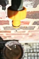 drip drip (Jo) Tags: reflection brick water drops bucket dof bokeh falling brickinthewall flickrandroidapp:filter=none