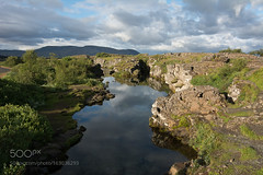 Tingvellir (LMortgages158) Tags: sky water travel blue clouds green beautyful summer iceland lake national park unesco parliament islande ridge thingvellir world heritage site ingvellir midatlantic rift midatlanticridge nationalpark worldheritagesite