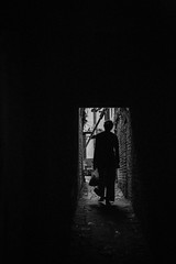Alleway BW (Crossing China) Tags: nepal kathmandu ktm travel travelphotographer portrait street streetphotography streetportrait himalayas mounteverest mountains mountain mountainflight shadow girl cute nepali nepalese sunset alley blackandwhite monochrome