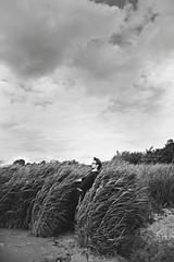 storm (AntjeEgbert) Tags: portrait sky bw storm man beach clouds strand glasses bend wind outdoor himmel wolken sw gras mann brille wetter schilf sturm windig biegen gebogen wolkenhimmel strmisch