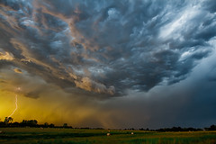 The Approaching Storm (tlc) Tags: sky storm field clouds rural landscape oz kansas thunderstorm lightning 1022mm haybales canon7d