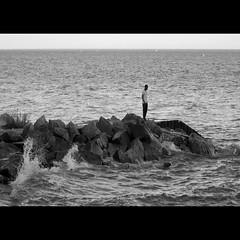 Solitude (Michael Mitchener) Tags: bw lake man beach water surf beaches lakeontario breaker